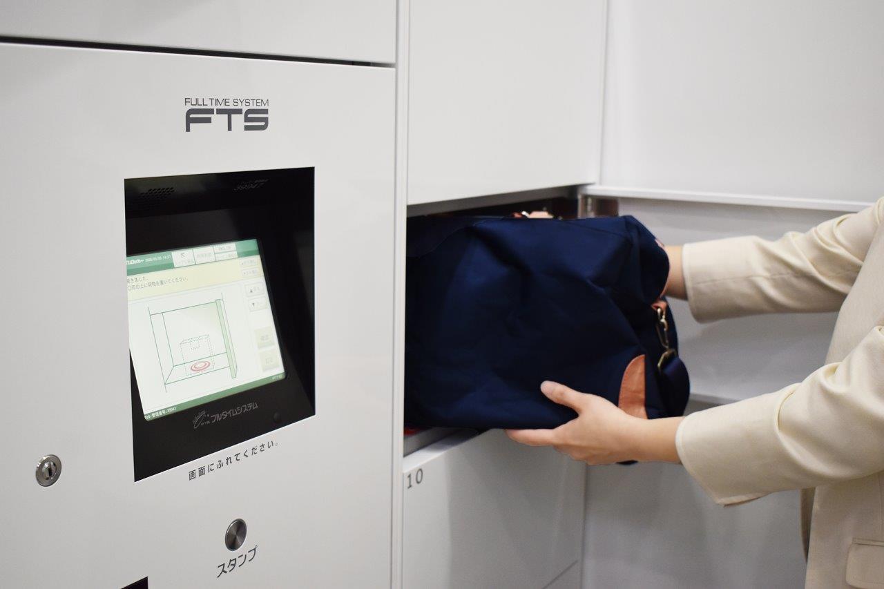 フルタイムシステム、入院患者に荷物を非対面で受渡し